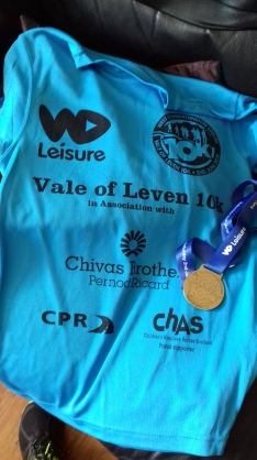 tee shirt and medal for a 10k run